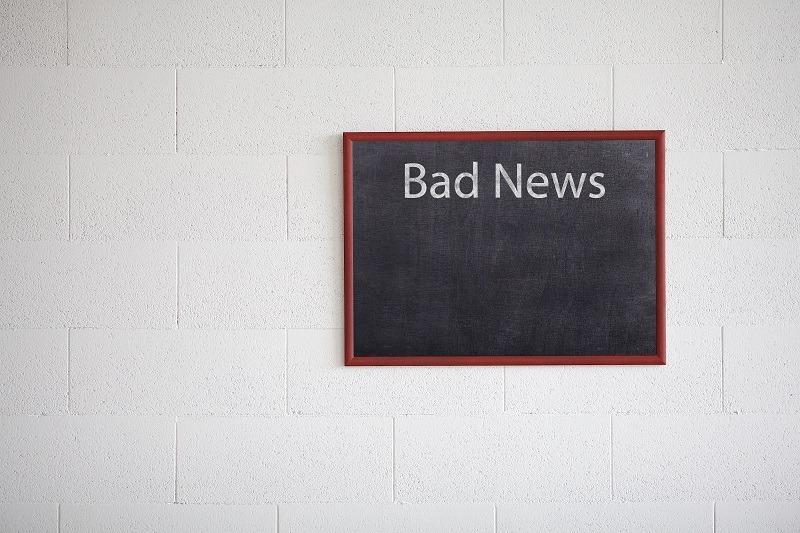 Bad news written on a chalkboard