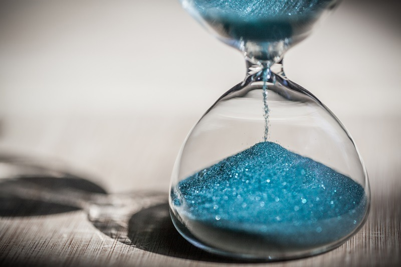 Sand trickling through time keeper