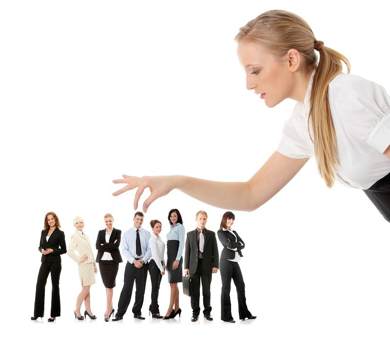 Businesswoman selecting individual from a group