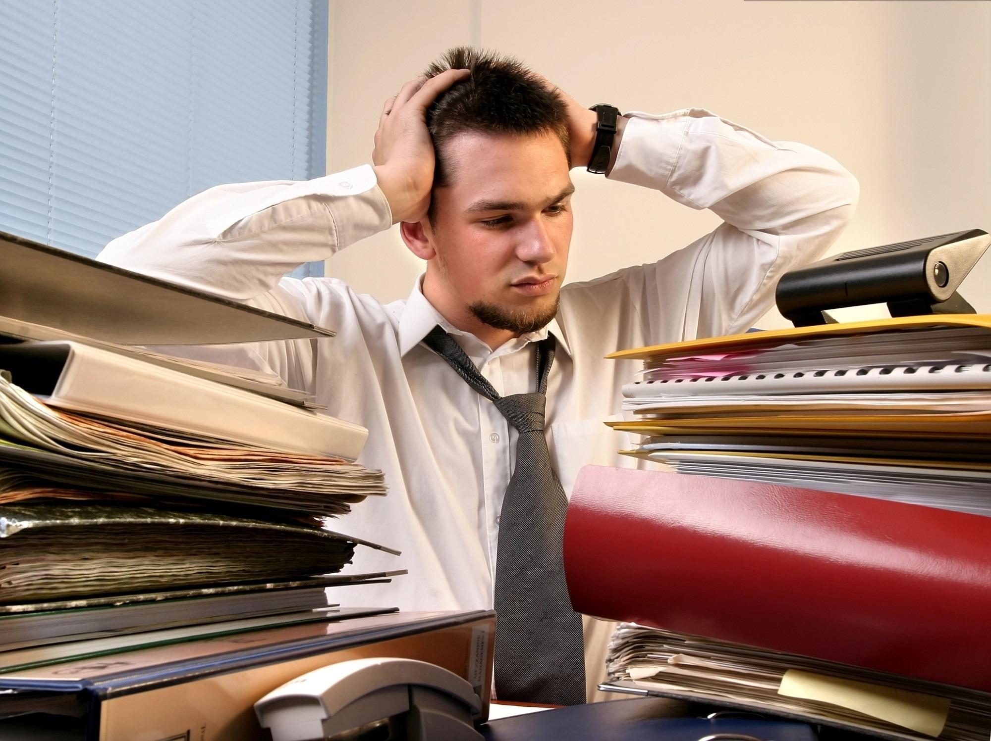 Overwhelmed businessman