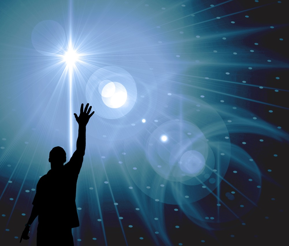 Man reaching toward the stars